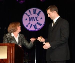 Outgoing OVMA President Dr. Linda Lord passes the gavel to incoming President Dr. Ryan Zimmerman at an awards ceremony held at the annual Midwest Veterinary Conference.