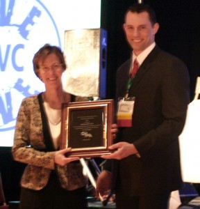 Former State Public Health Veterinarian Dr. Kathy Smith was honored with the OVMA's Veterinarian of the Year Award, presented by outgoing President Dr. Ryan Zimmerman.