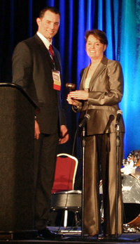 Dr. Patricia Haines accepts the gavel of the OVMA president from Dr. Ryan Zimmerman