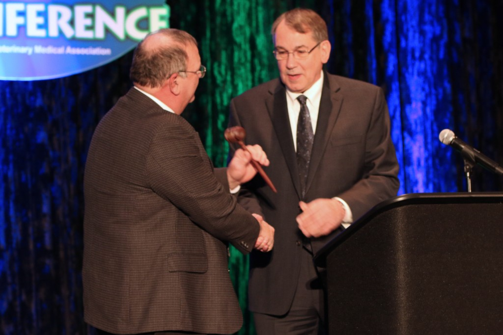 Dr. Brad Garrison (left) accepts the gavel of the OVMA President from Dr. David Koncal.
