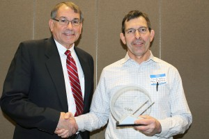 Dr. Richard Wiley (right) was recognized with the OVMA's Distinguished Service Award, given by outgoing President Dr. David Koncal.